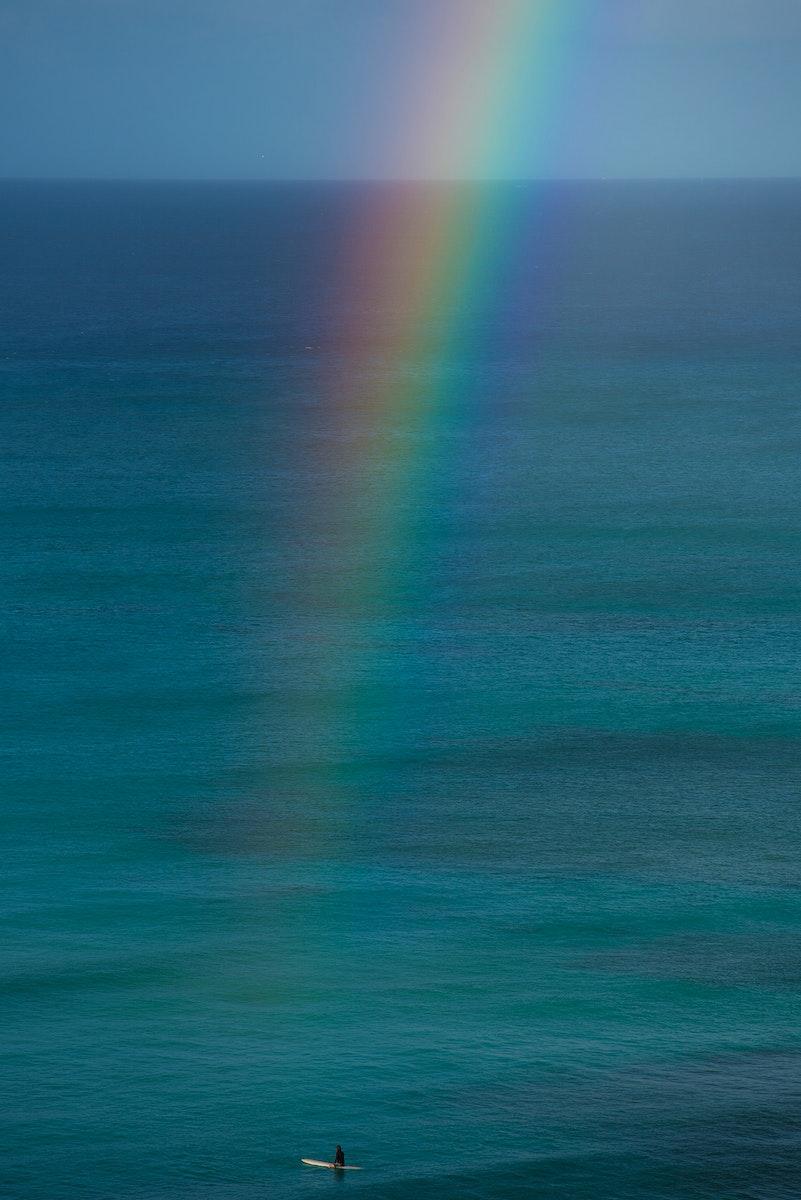 Rainbow streak with a blue ocean