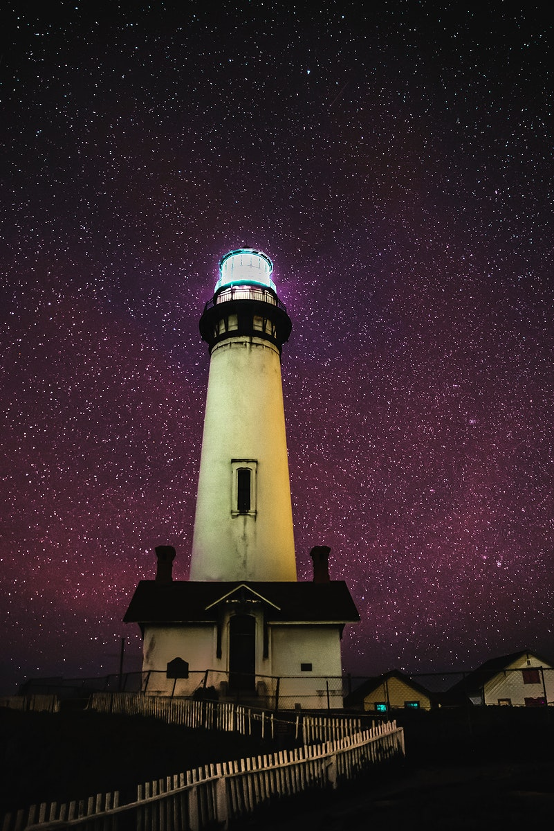 Pigeon Point Light Station with a starry night in San Francisco Bay, California USA