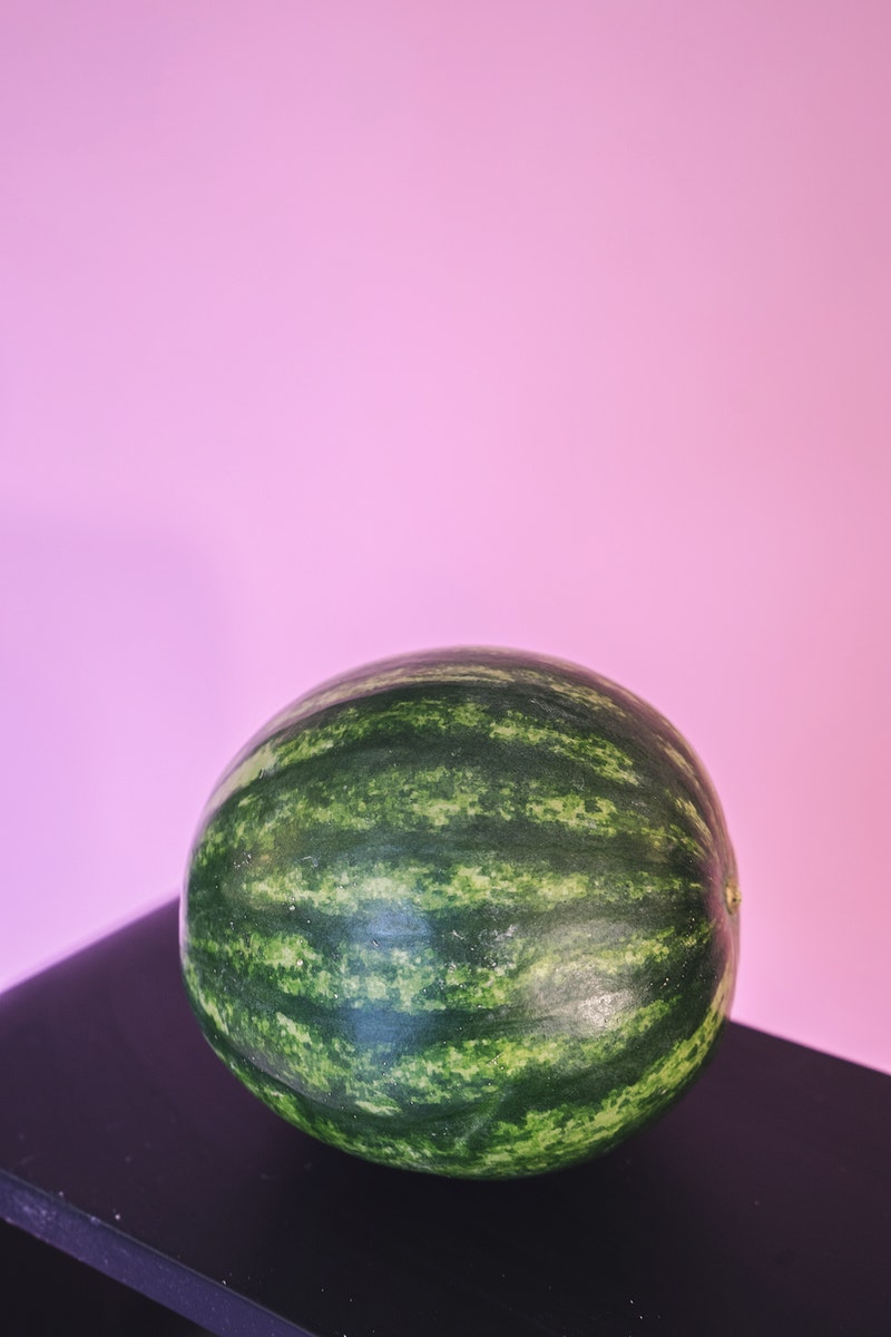 Whole watermelon on pink background