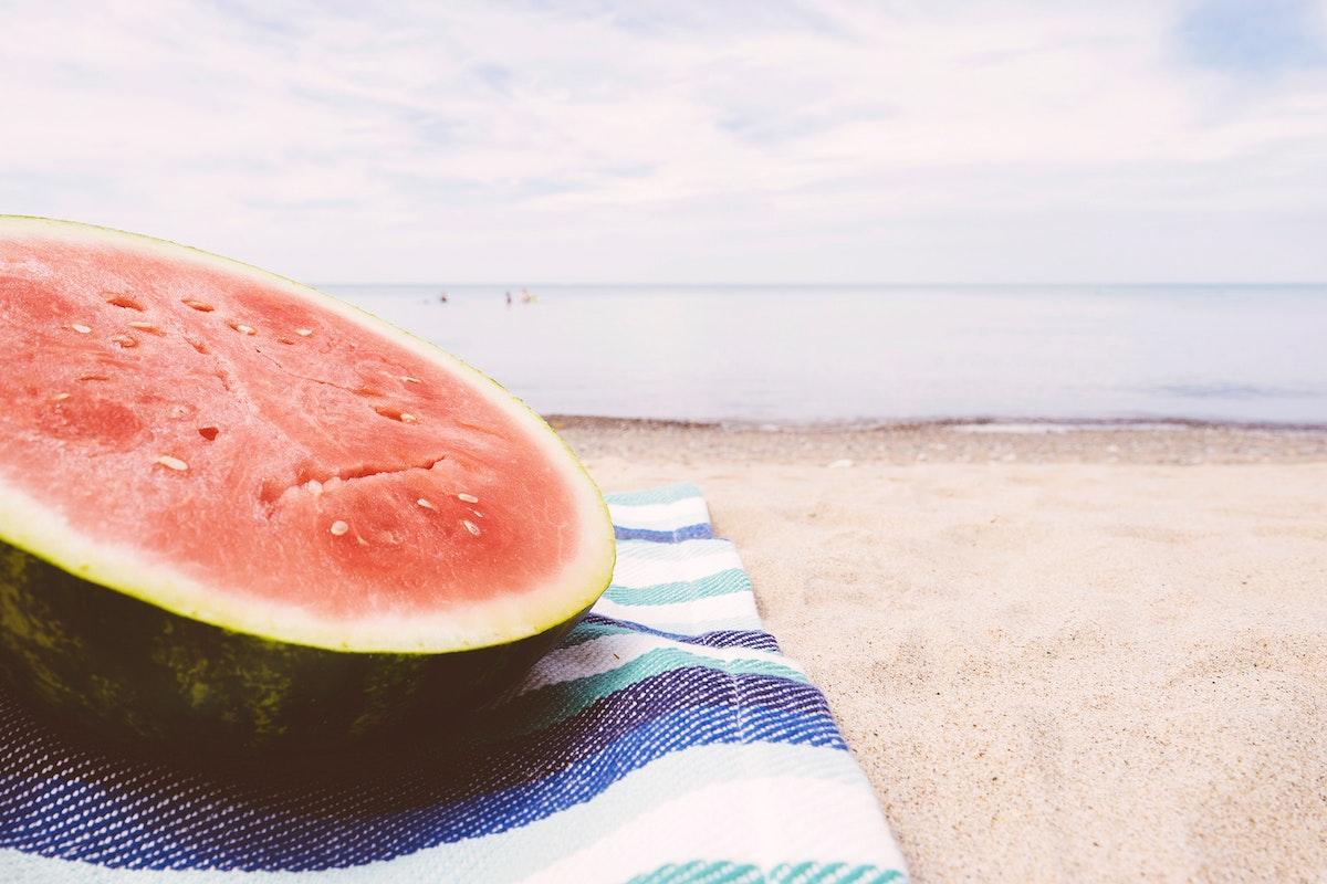 Half of a watermelon on the beach
