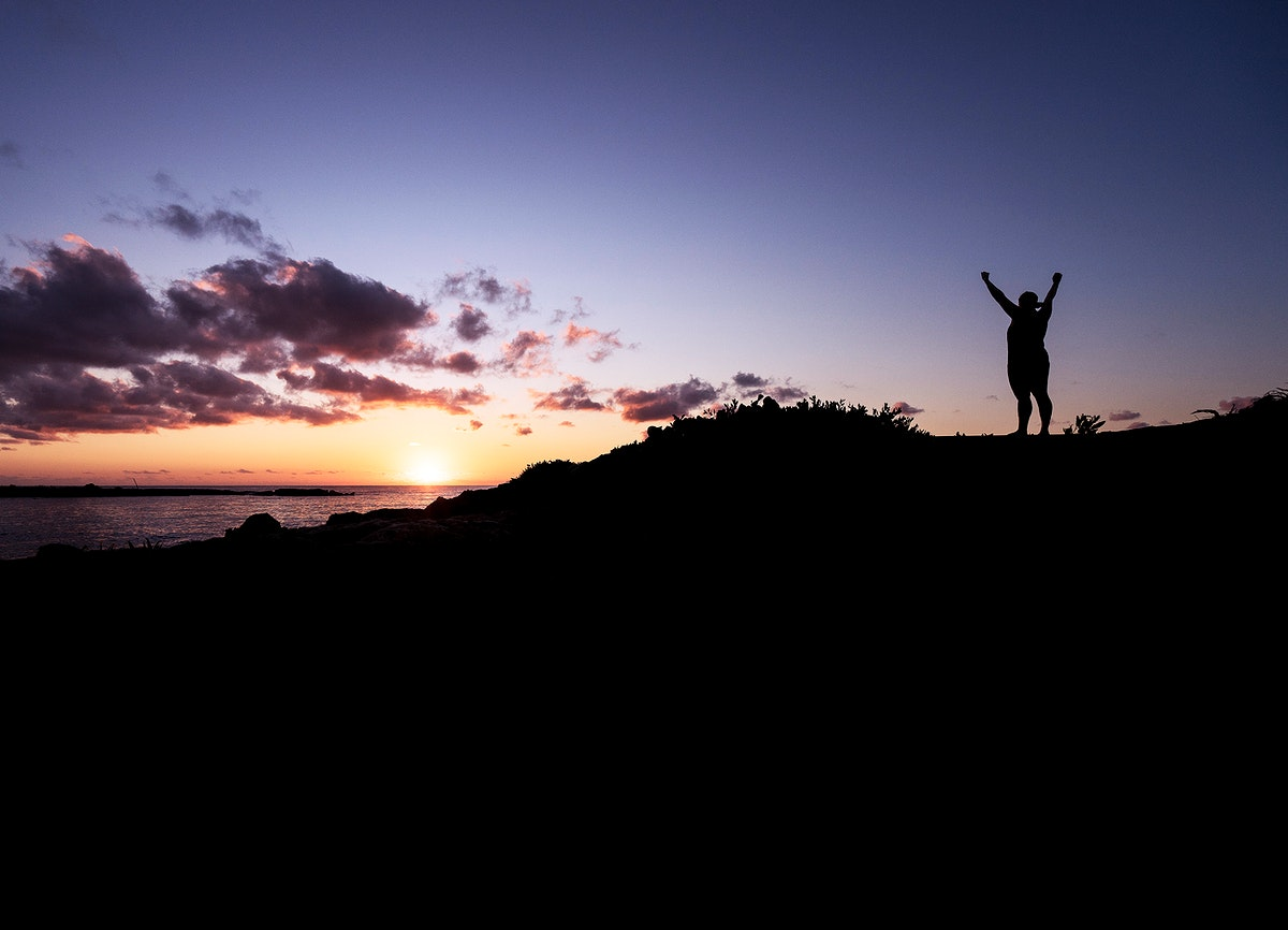 Man standing on top of a hill