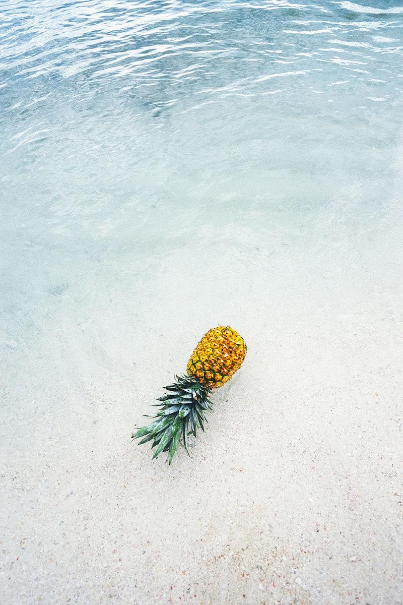 Ripe pineapple on the seashore