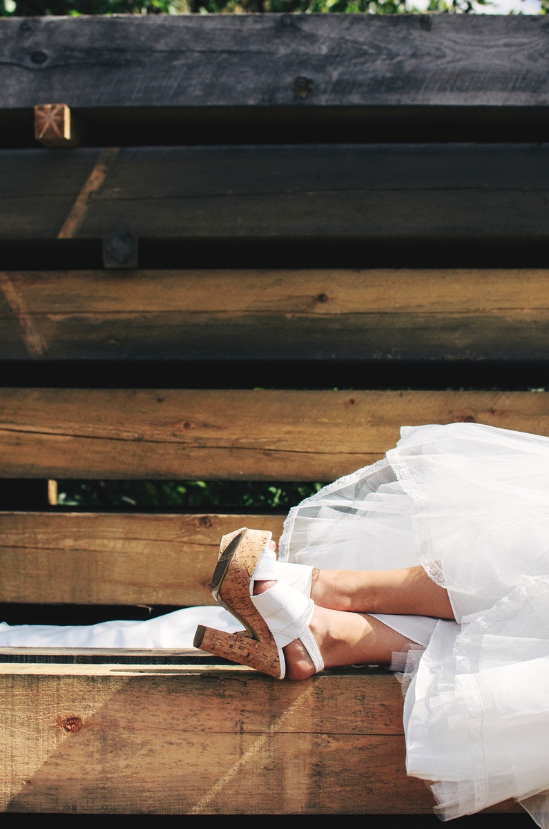 Bride taking a nap on some wood