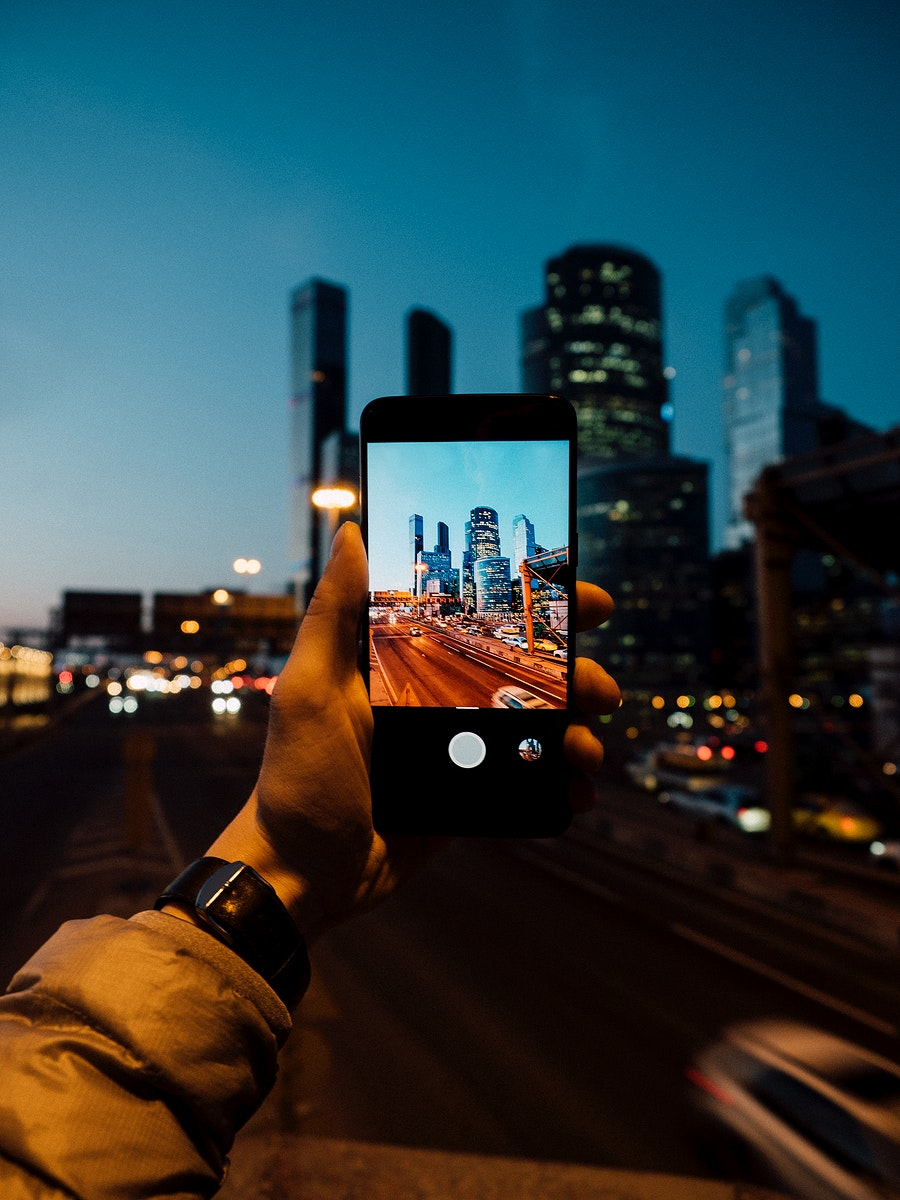 Night view of Moscow city, Russia on a mobile phone screen