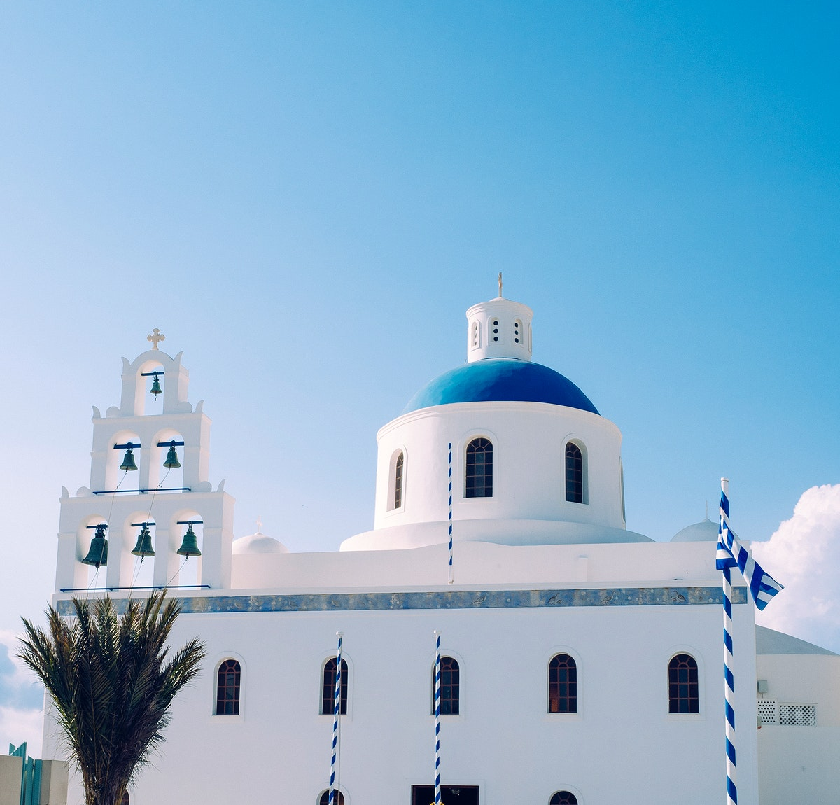 View of whitewashed and blue domed church in Santorini, Greece