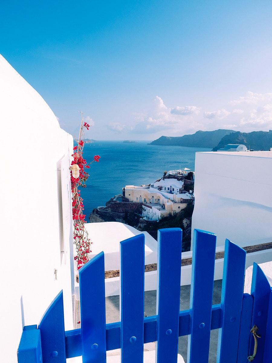 Scenic of Oia traditional white painted house with Aegean sea view in Santorini, Greece