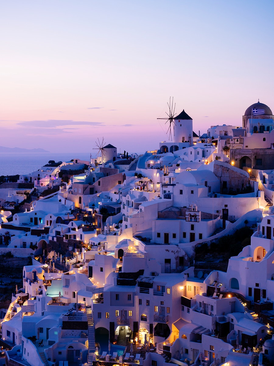 Night view of Oia traditional cave houses in Santorini, Greece