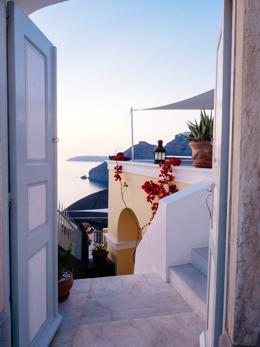 Scenic view of Oia, traditional white painted house, with Aegean sea view in Santorini, Greece