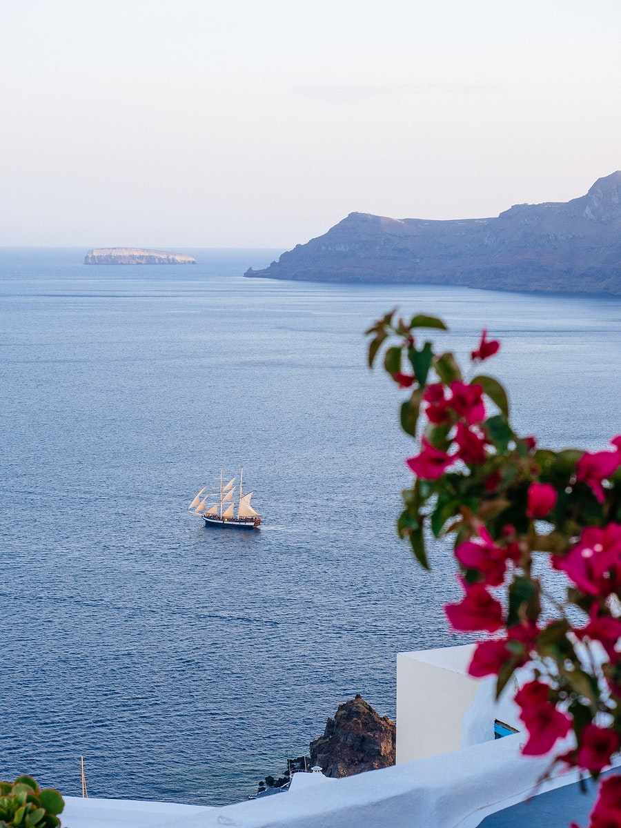 View featuring a sailboat in Santorini, Greece