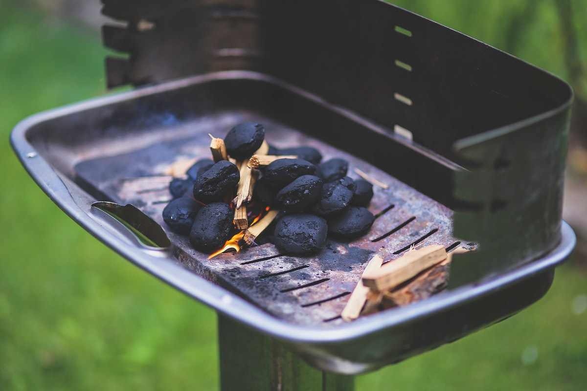 Burning charcoals in a barbecue grill. Visit Kaboompics for more free images.