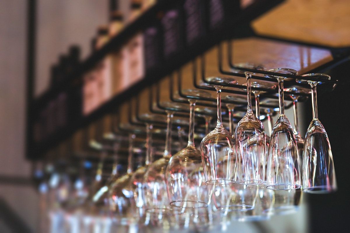 Wine glasses hanging in a bar. Visit Kaboompics for more free images.