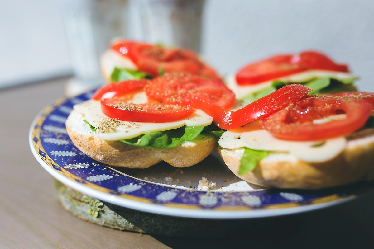 Open faced sandwiches with tomatoes. Visit Kaboompics for more free images.