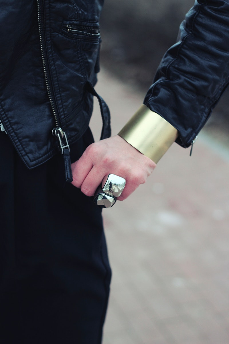 Woman wearing a large bracelet. Visit Kaboompics for more free images.
