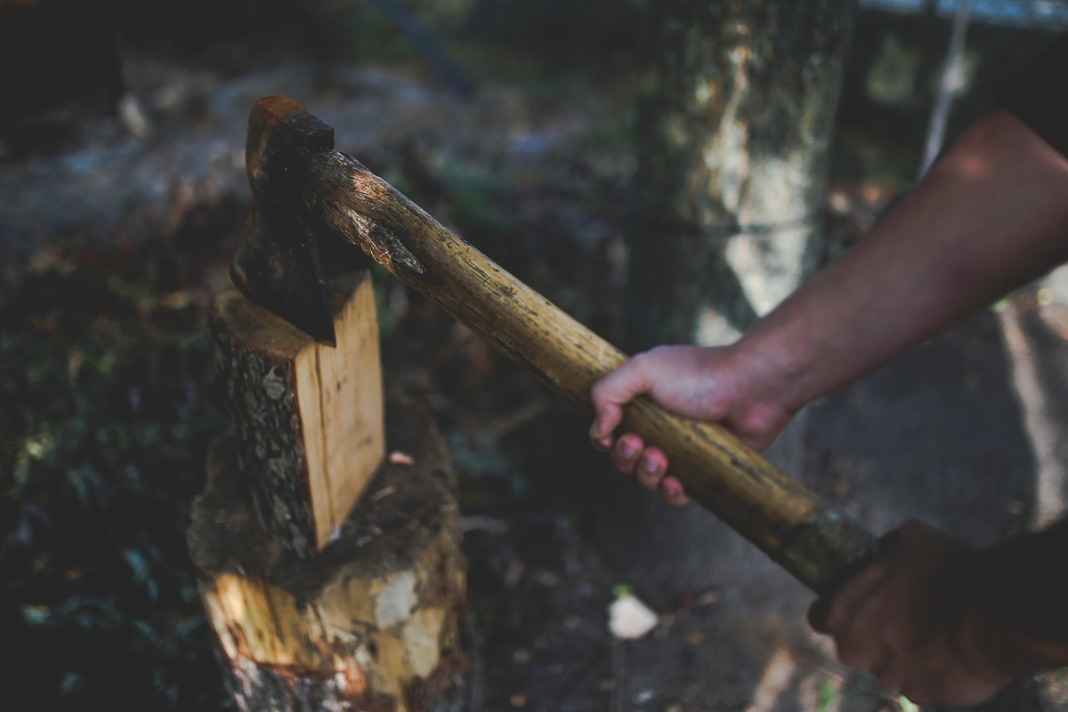 Man chopping firewood. Visit Kaboompics for more free images.
