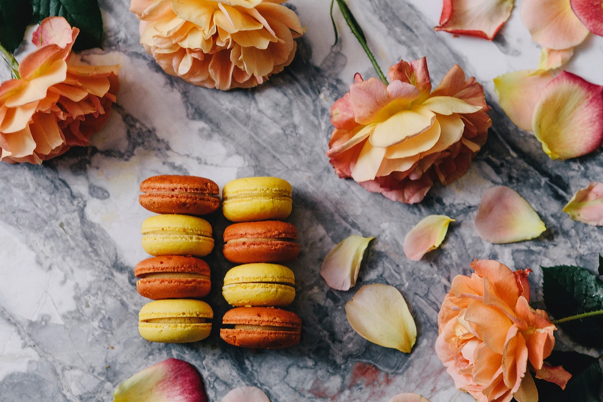 Orange and yellow macaroons. Visit Kaboompics for more free images.