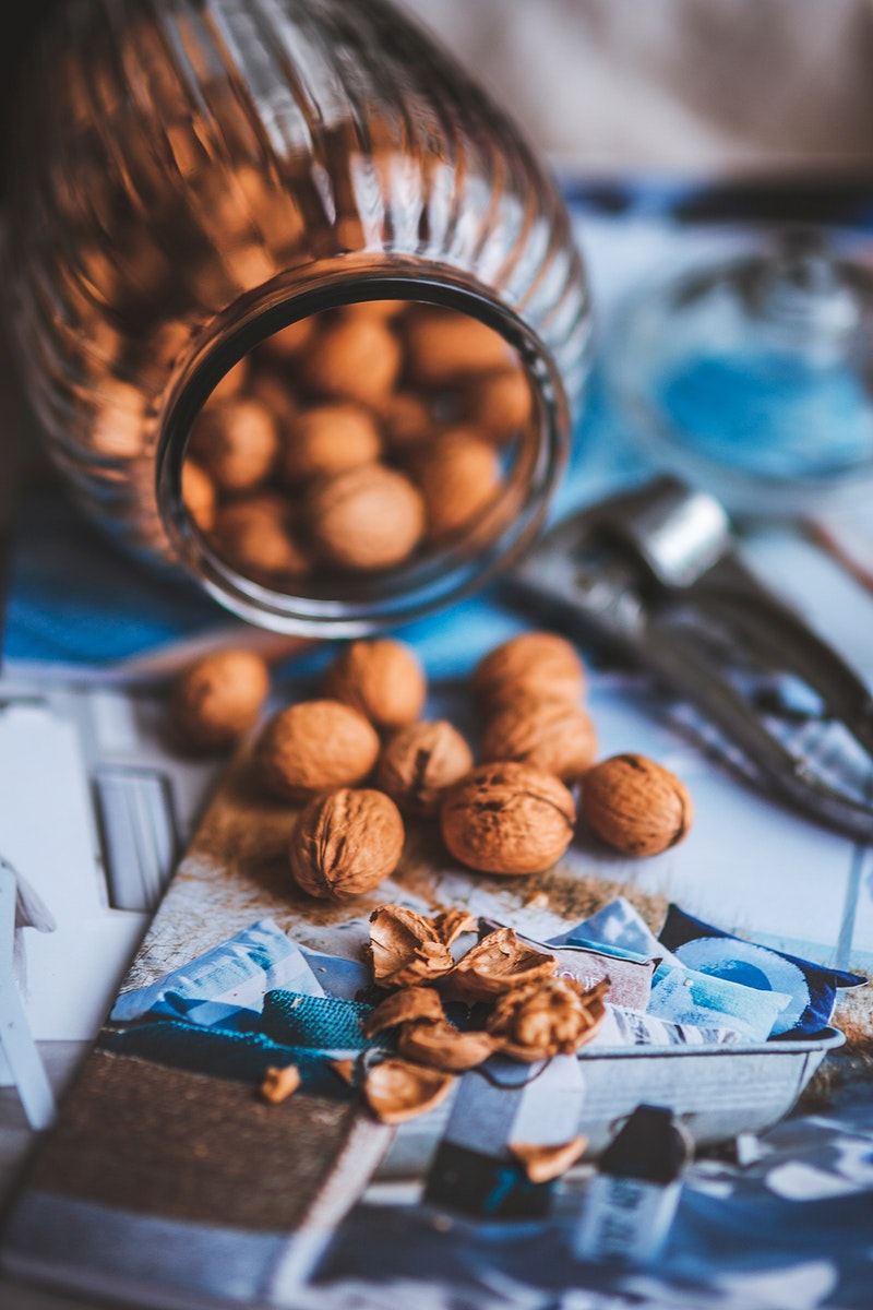 Jar of whole walnuts. Visit Kaboompics for more free images.