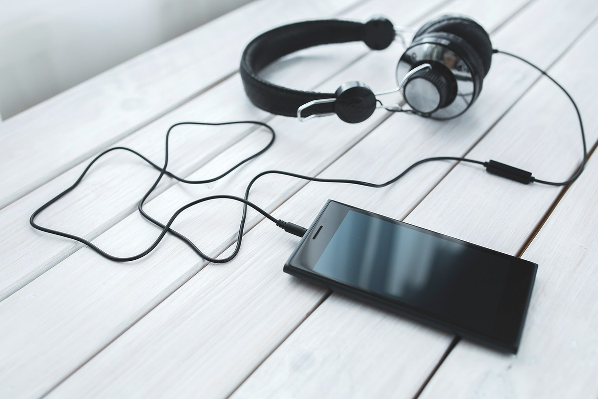 Smartphone with headphones. Visit Kaboompics for more free images.