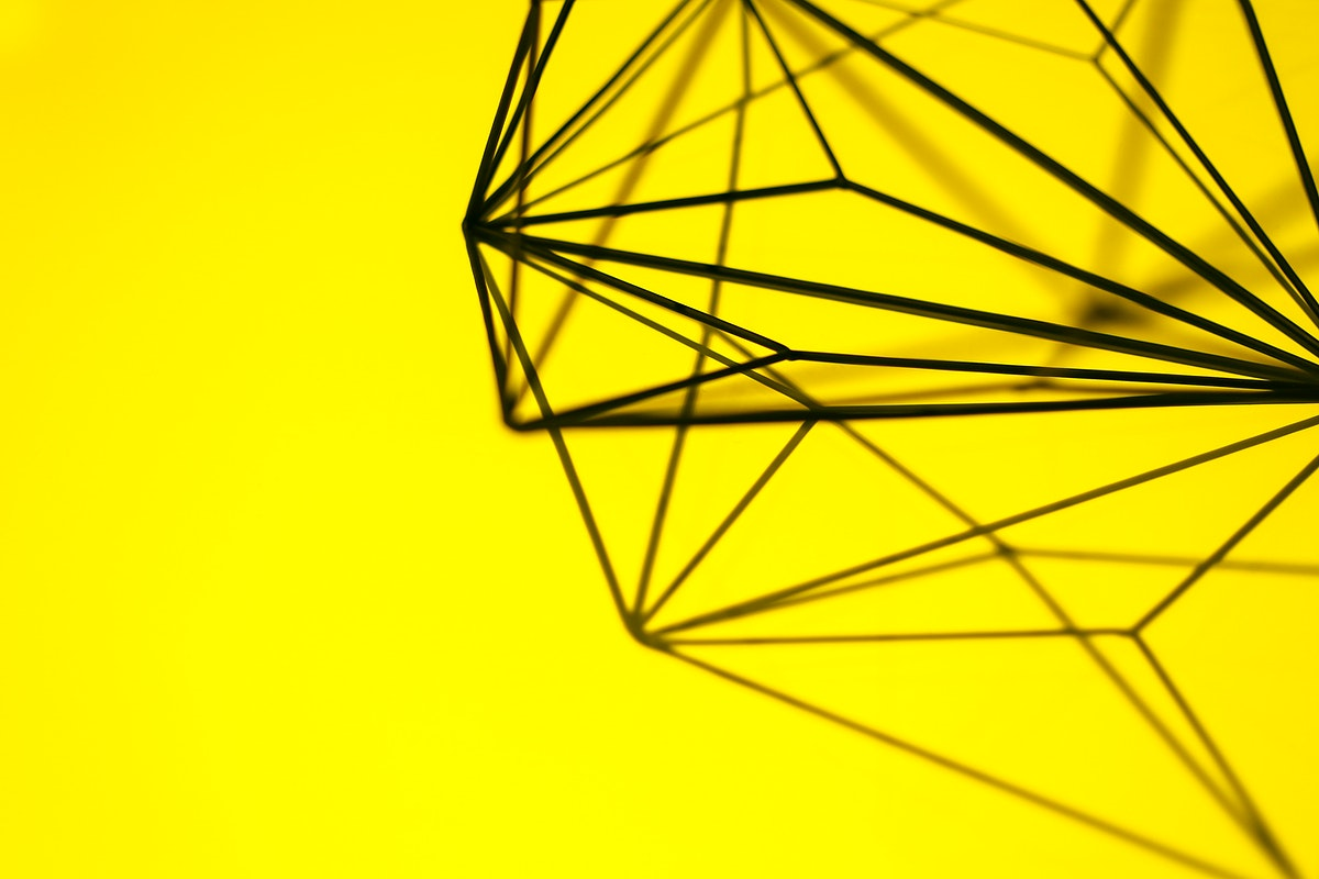 Geometrical shape on a yellow background. Visit Kaboompics for more free images.