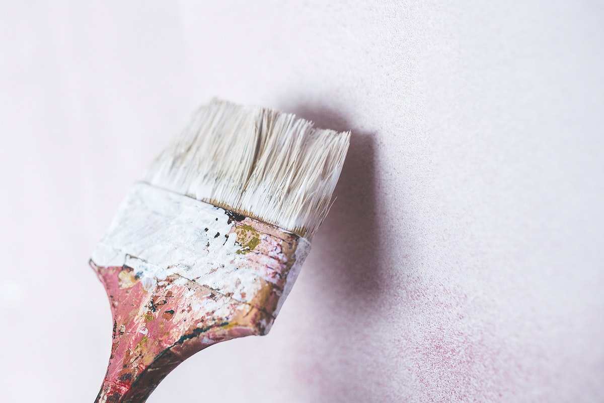 Paintbrush with white paint. Visit Kaboompics for more free images.
