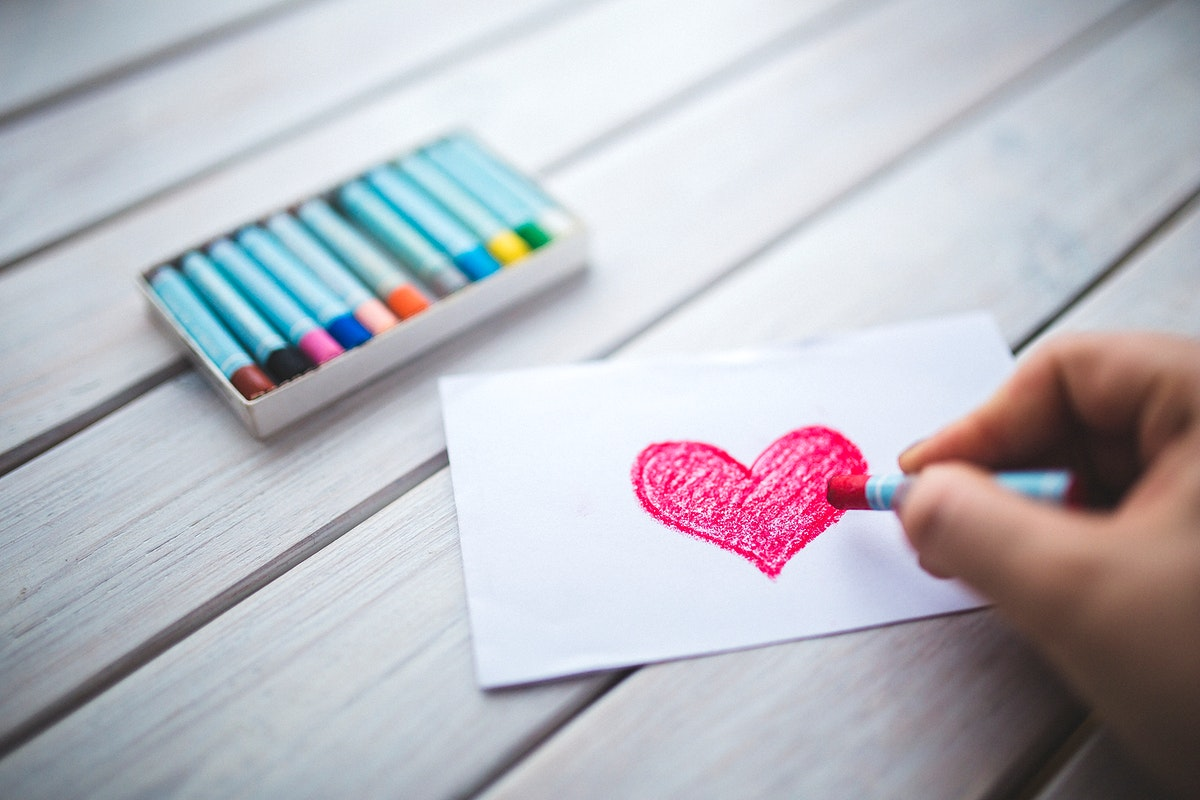 Red heart on a piece of paper. Visit Kaboompics for more free images.