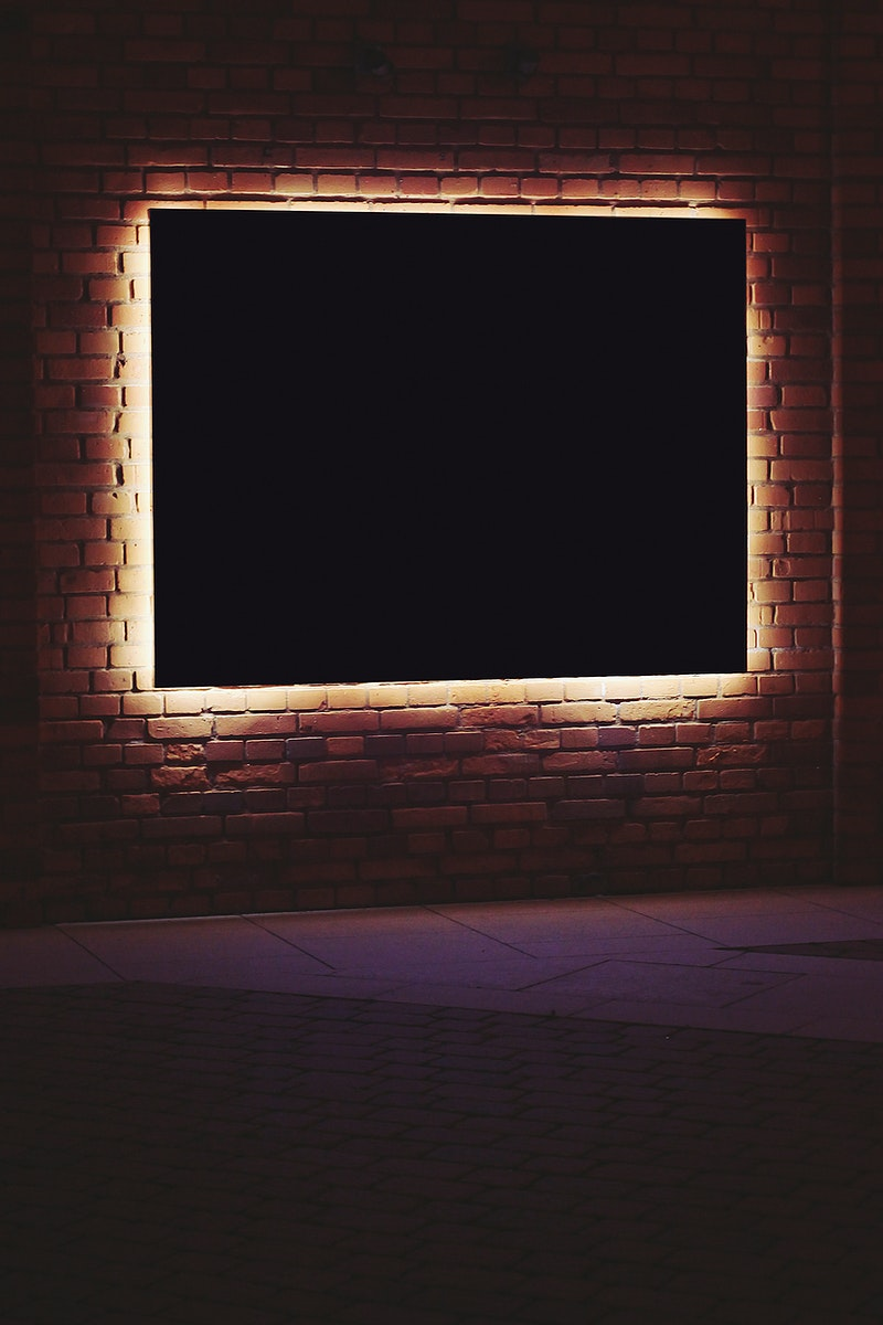 Frame with lighting in a dark room. Visit Kaboompics for more free images.