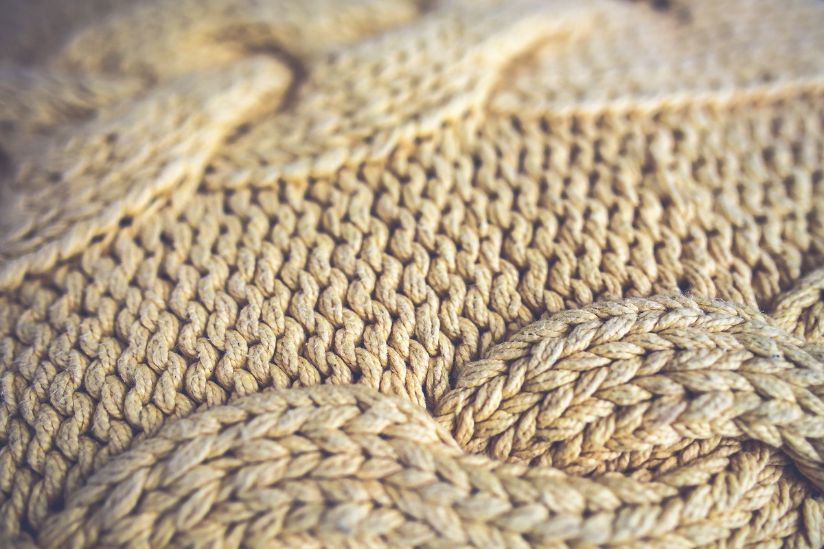 Close up of a knitted blanket. Visit Kaboompics for more free images.
