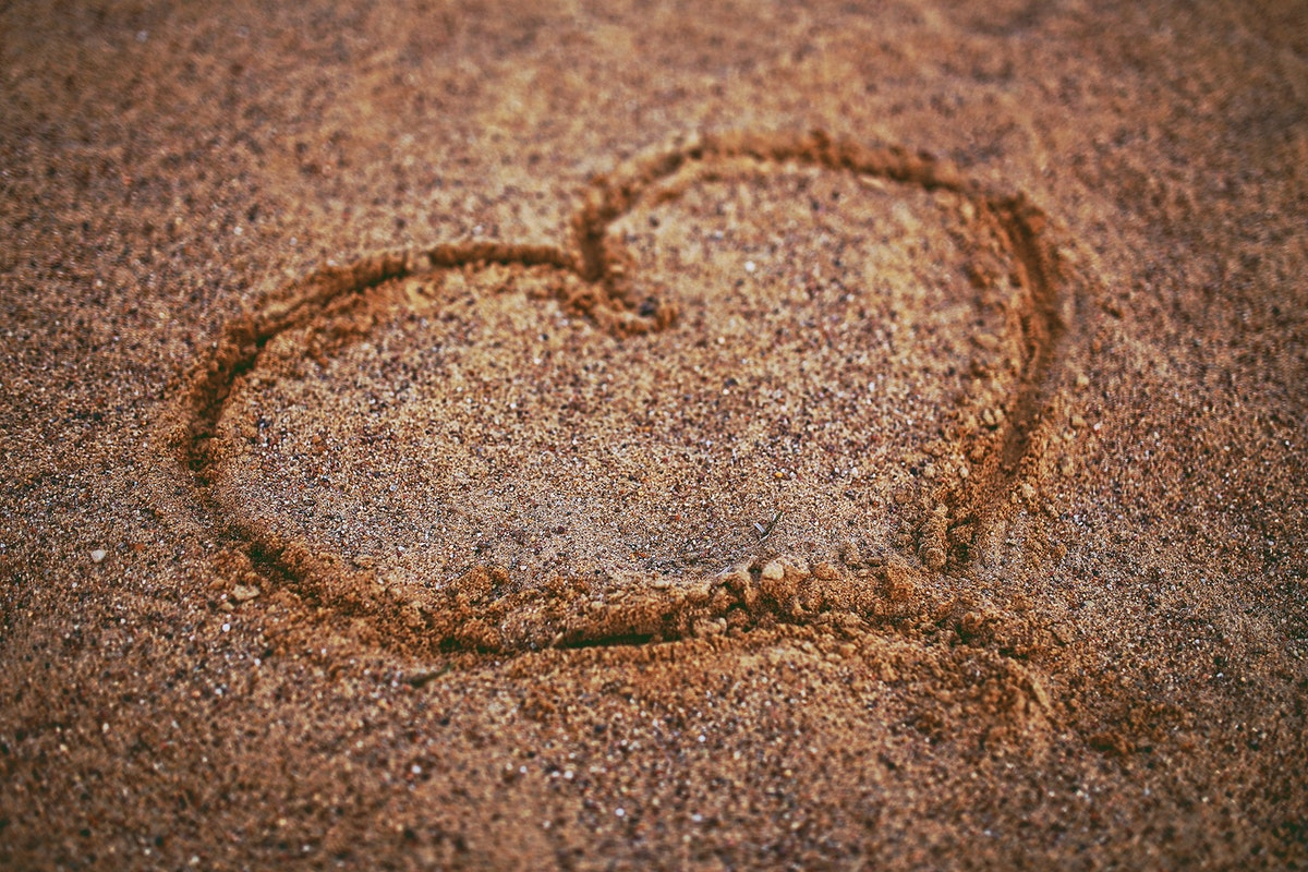 Heart drawn in the sand. Visit Kaboompics for more free images.