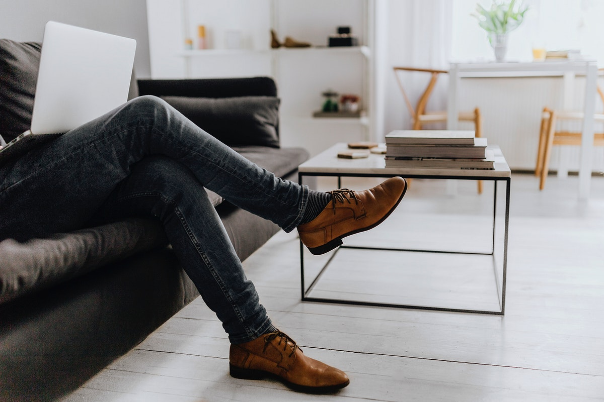 Man sitting in a sofa. Visit Kaboompics for more free images.