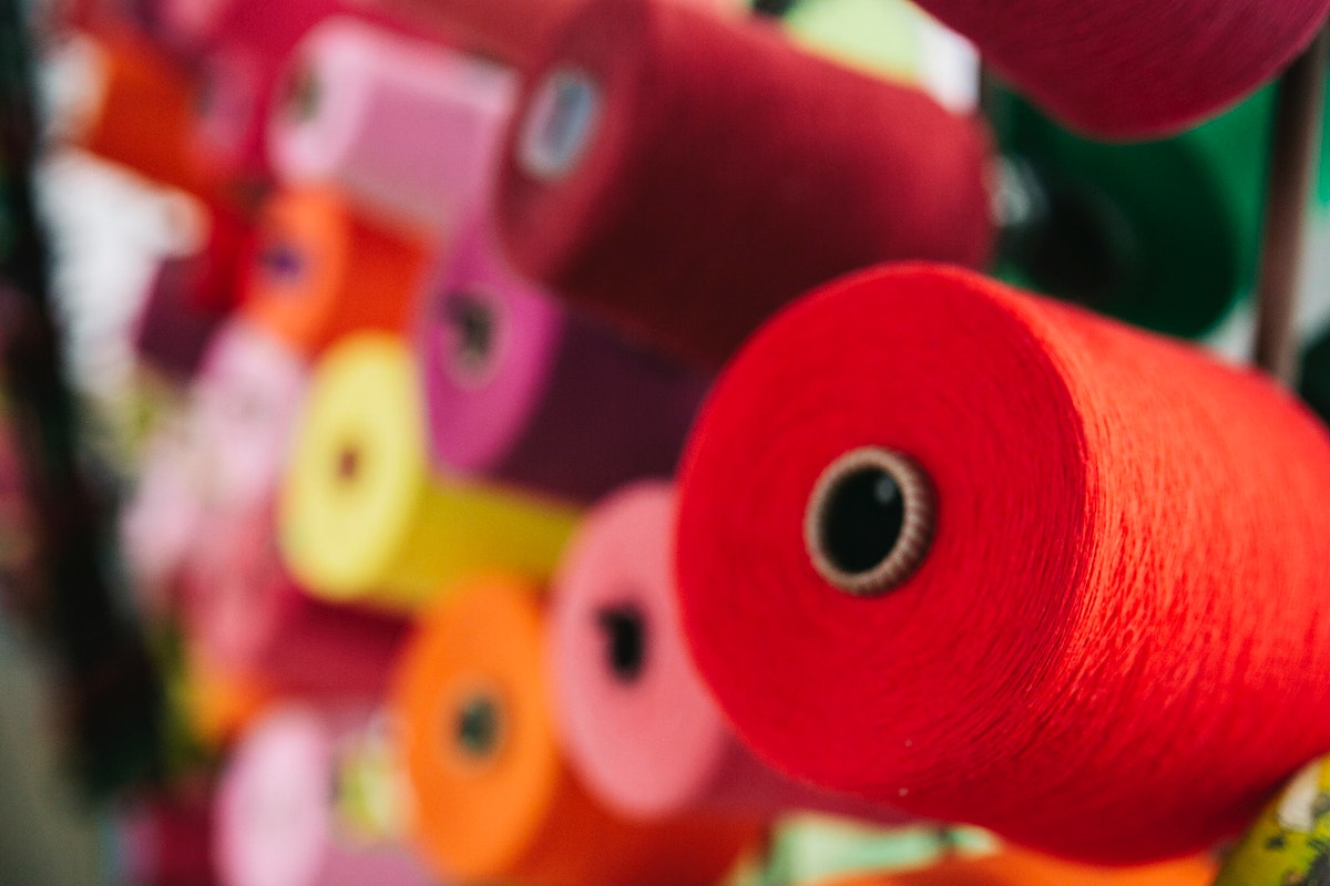 Spools of yarn on display. Visit Kaboompics for more free images.