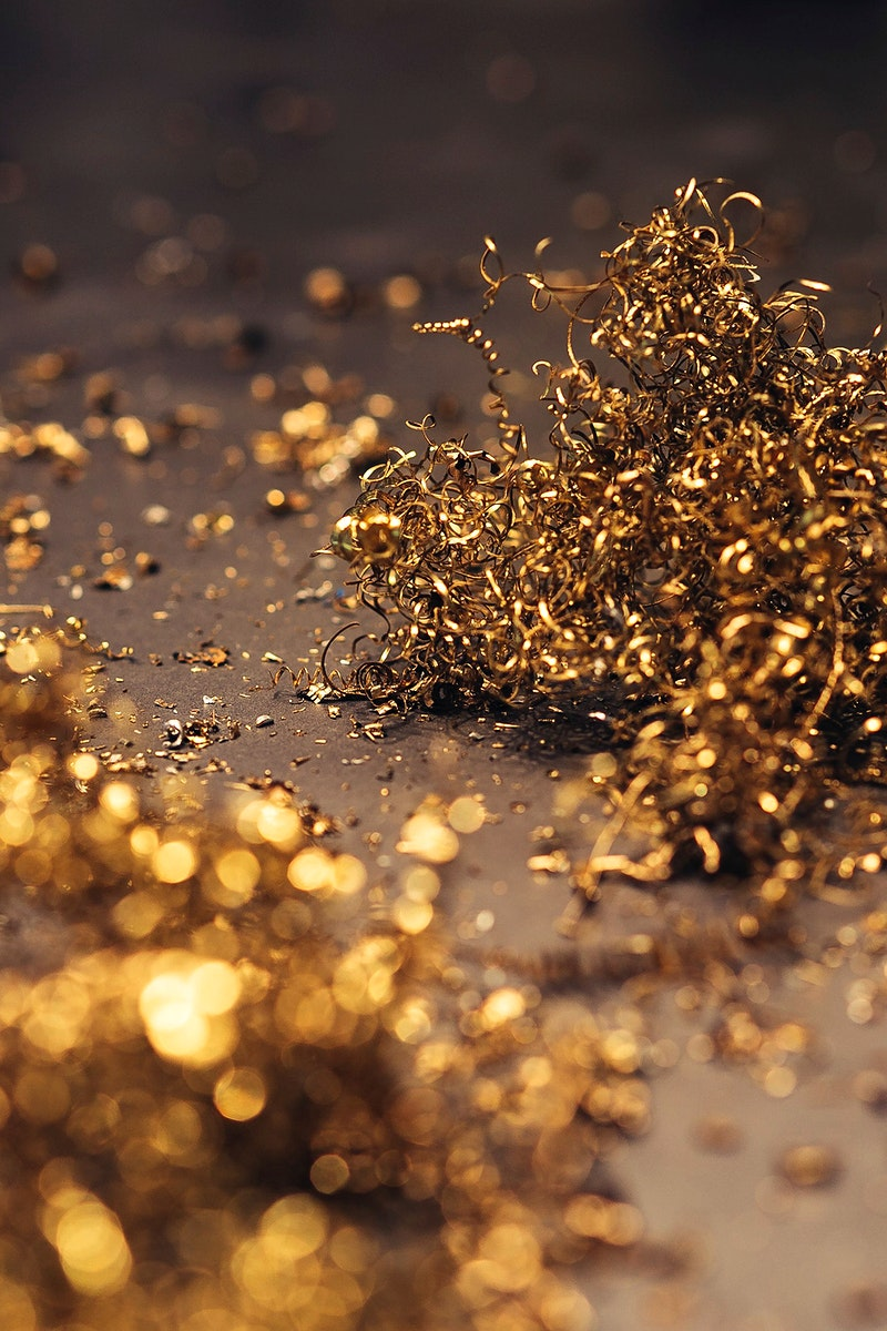 Close up of golden metal curls. Visit Kaboompics for more free images.