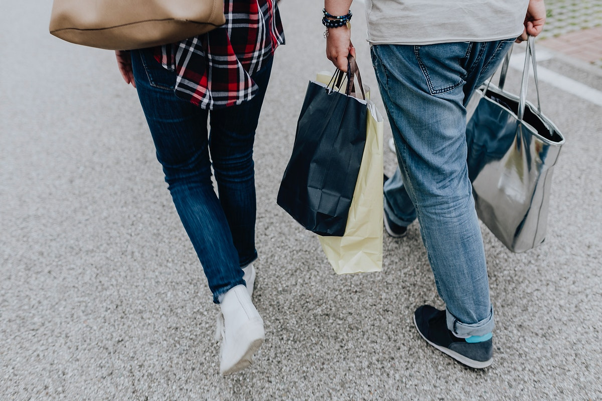 Couple walking with shopping bags. Visit Kaboompics for more free images.