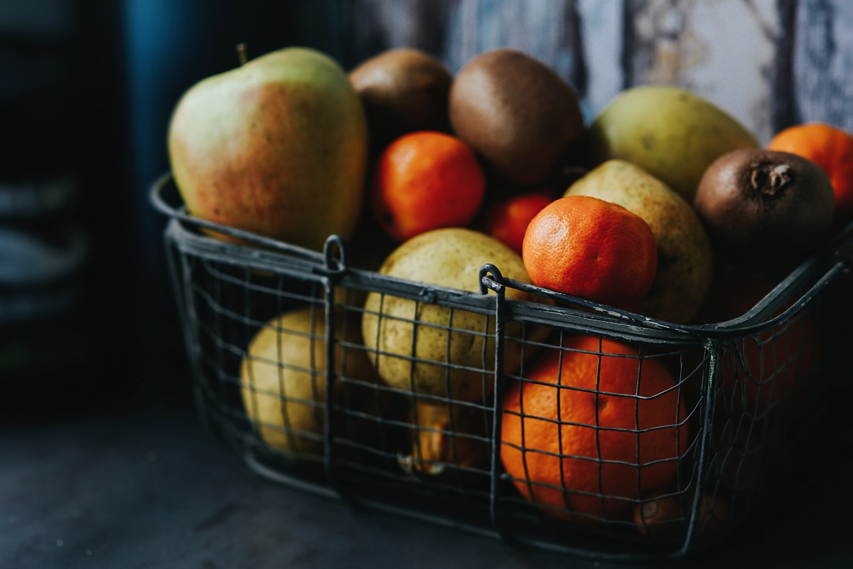 A basket full of fresh fruits. Visit Kaboompics for more free images.
