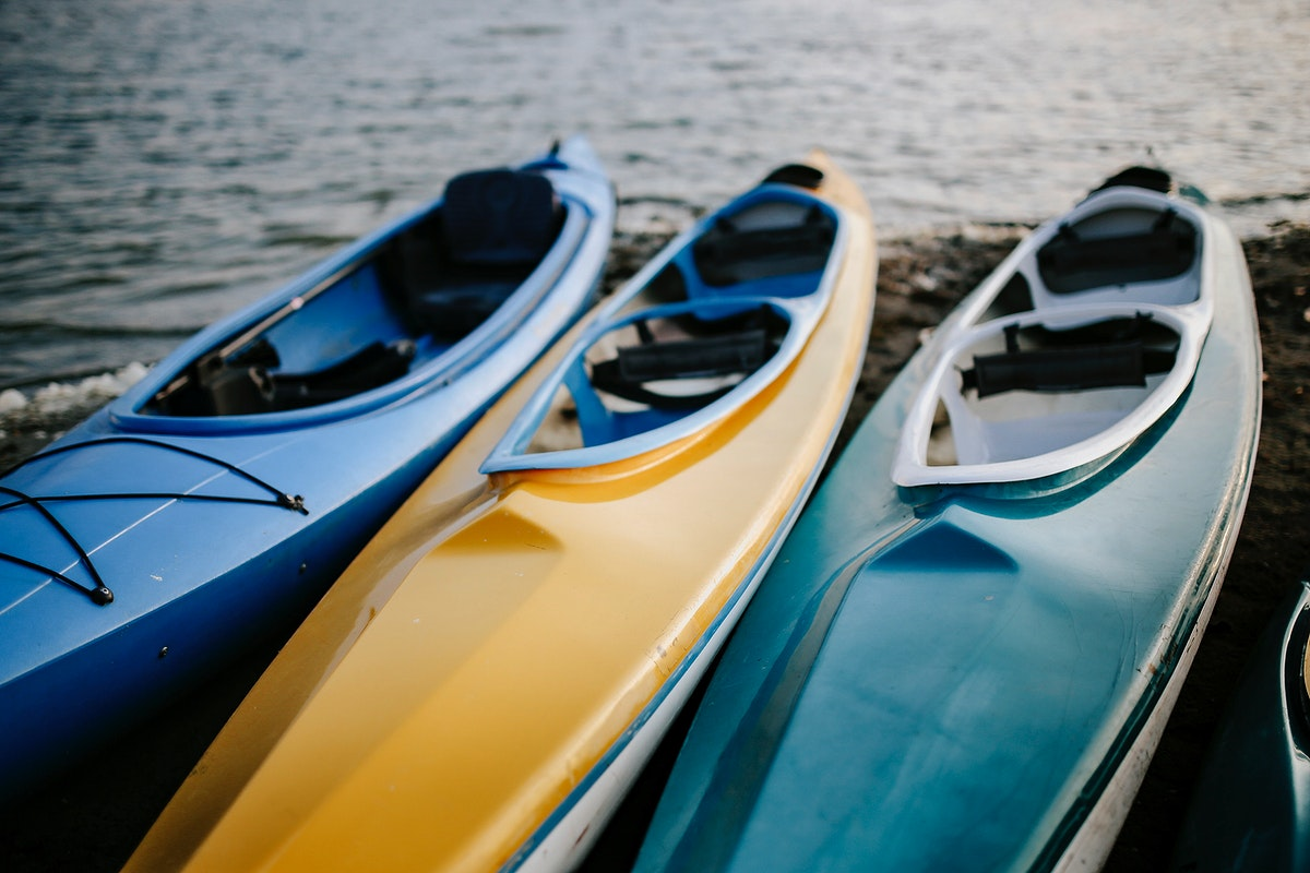 Colorful canoes in a lake. Visit Kaboompics for more free images.