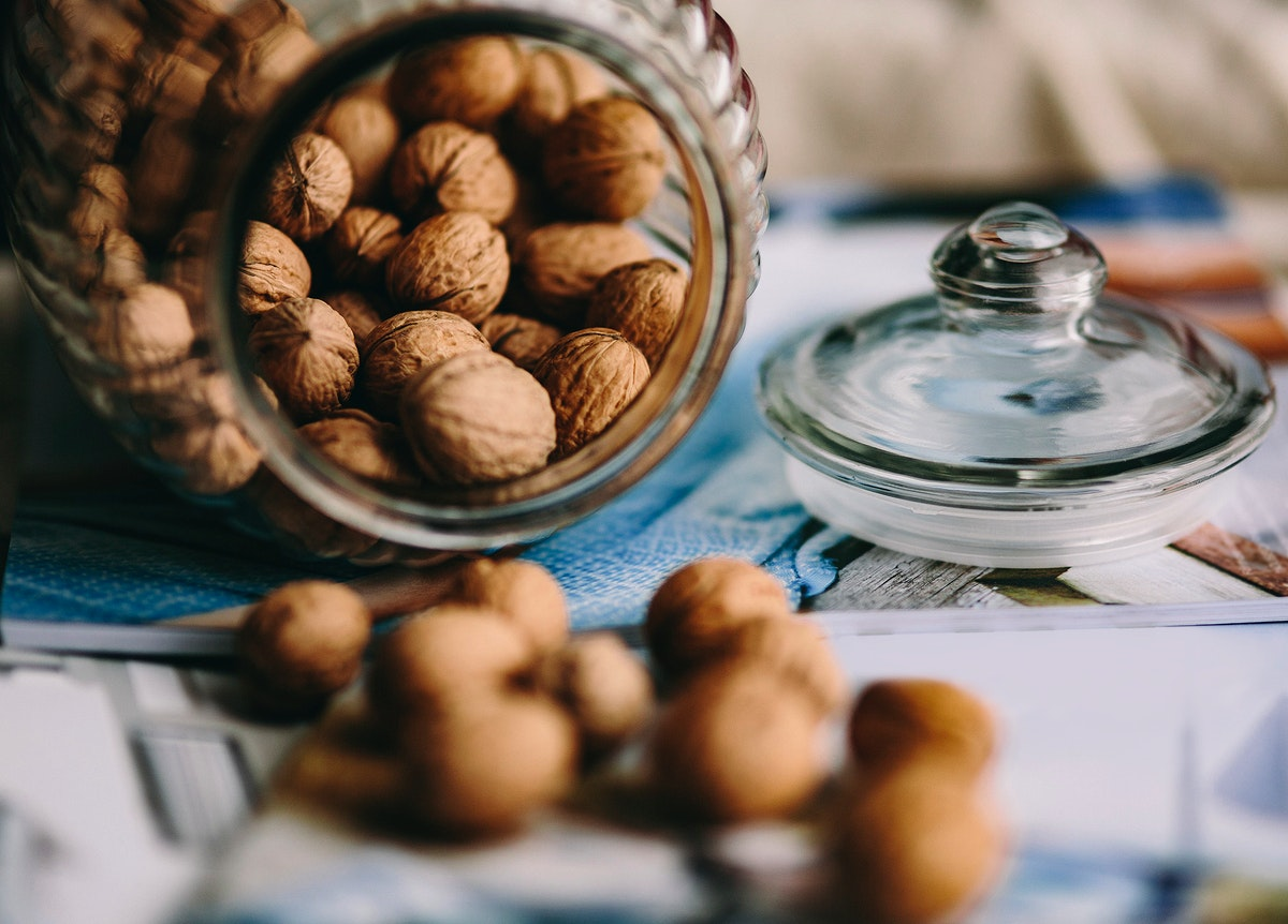 A jar full of walnuts. Visit Kaboompics for more free images.
