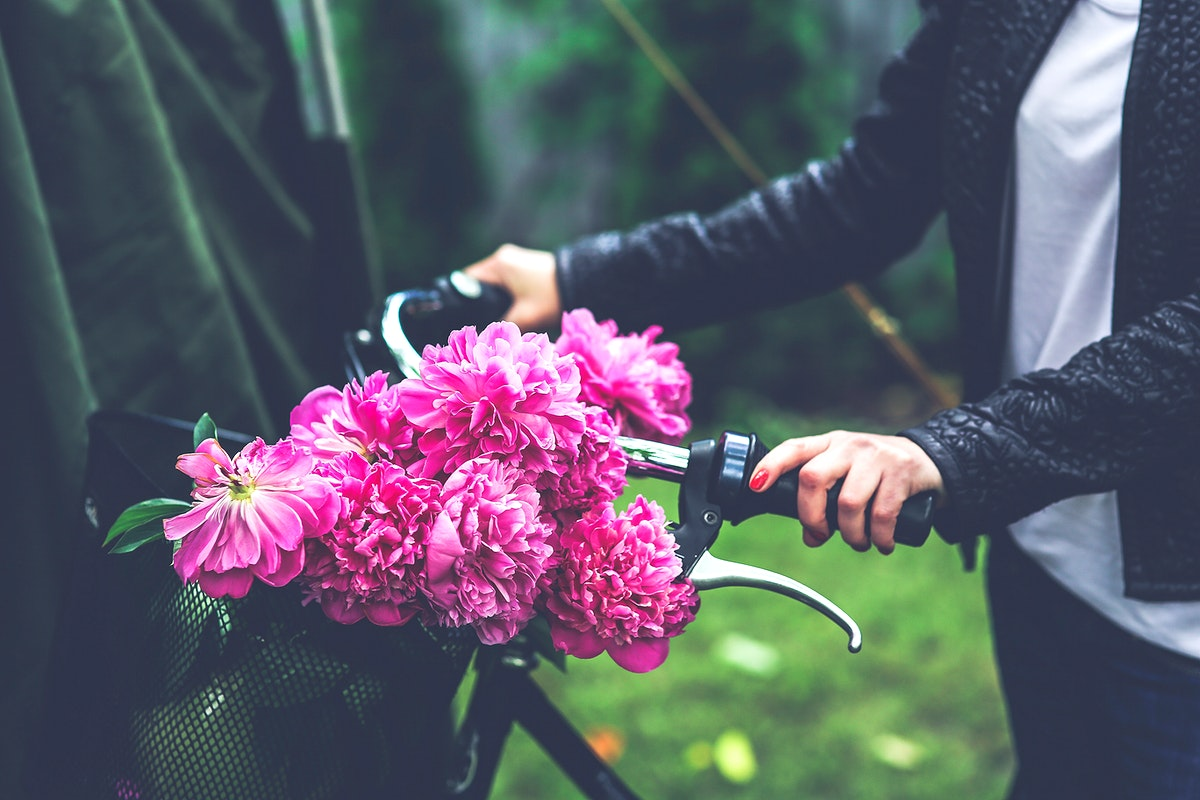 Woman with a bicycle. Visit Kaboompics for more free images.
