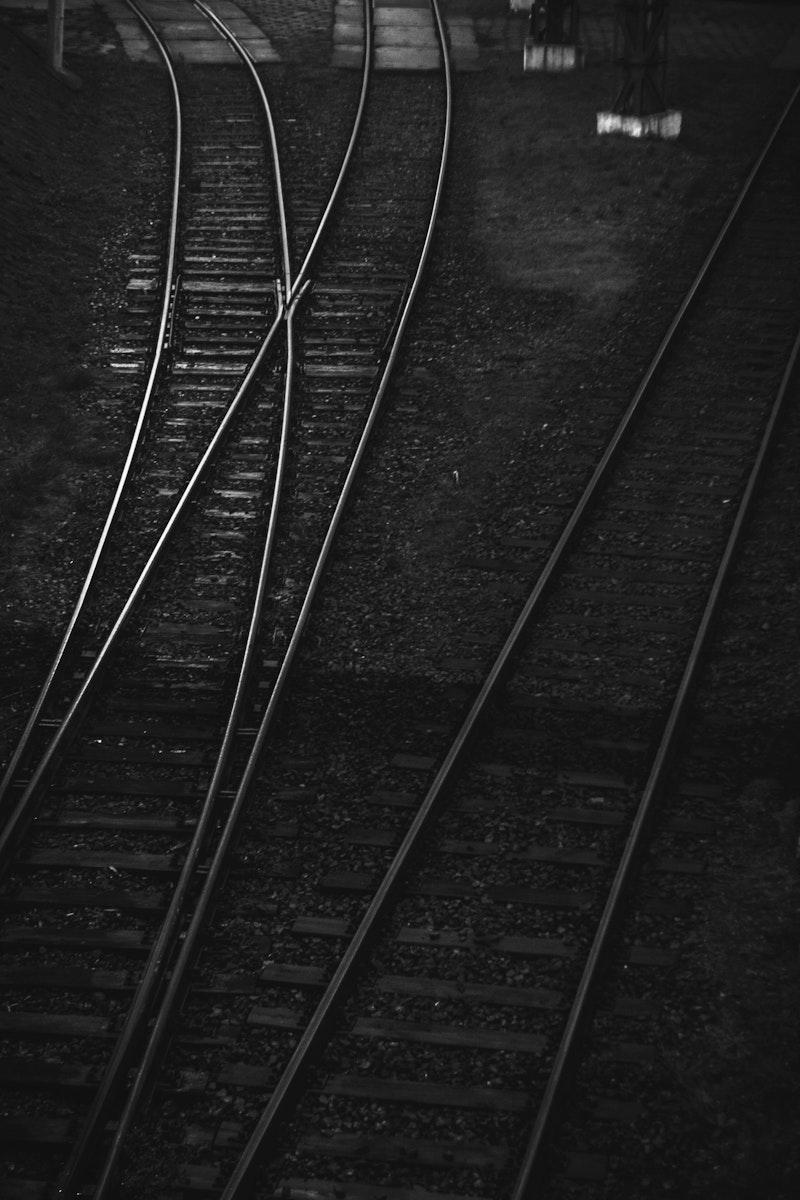 Dark railroad tracks. Visit Kaboompics for more free images.