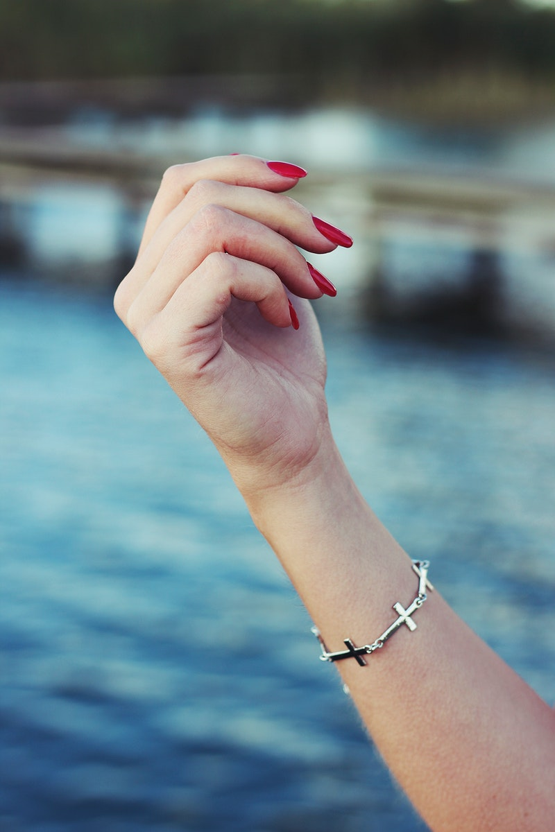 Woman wearing a bracelet. Visit Kaboompics for more free images.