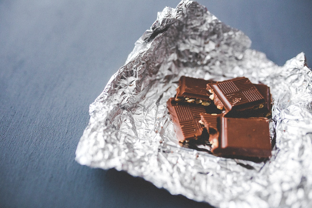 Pieces of milk chocolate. Visit Kaboompics for more free images.