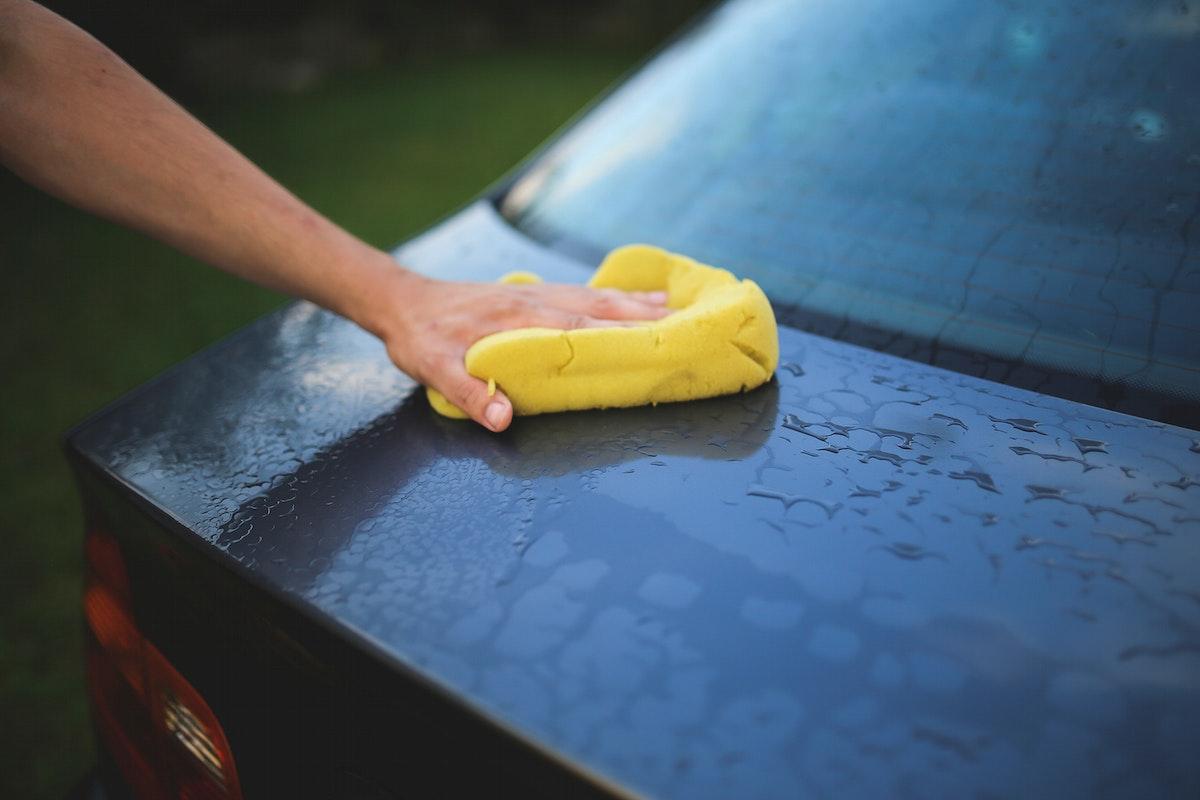 Man washing the car. Visit Kaboompics for more free images.