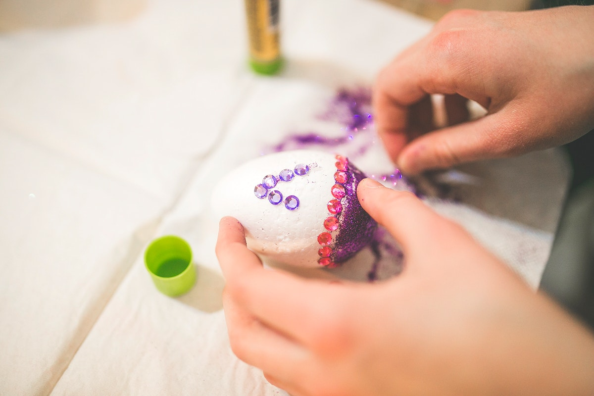 Woman decorating an egg. Visit Kaboompics for more free images.