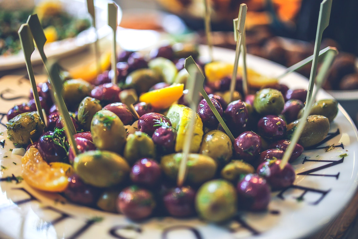 Plat of black and green olives. Visit Kaboompics for more free images.