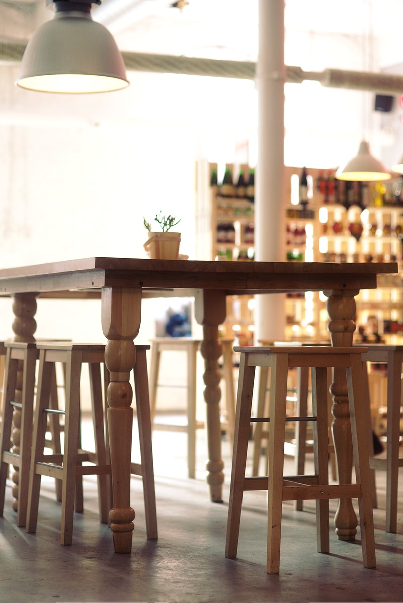 Wooden furniture at a cafe. Visit Kaboompics for more free images.