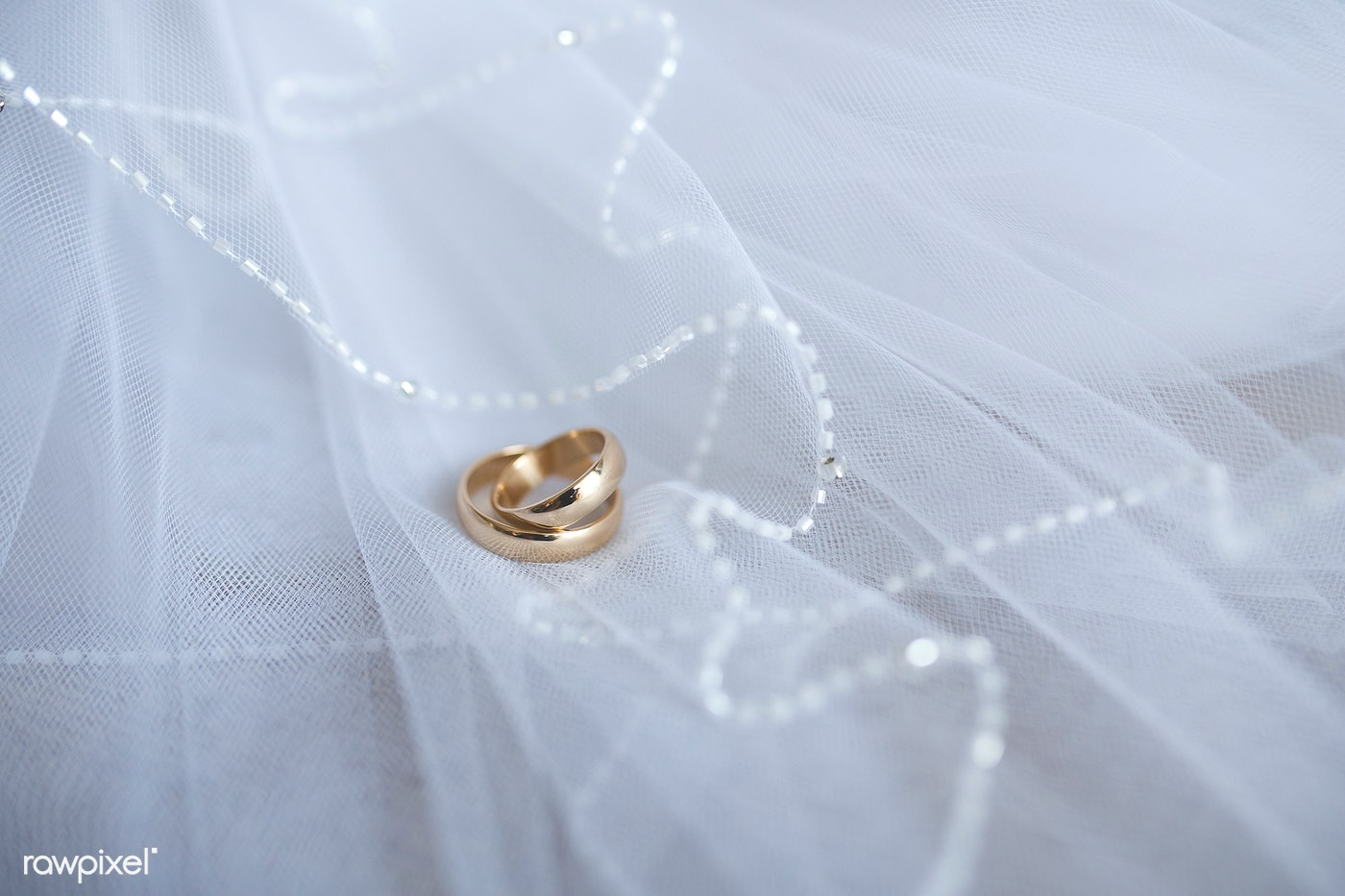 Gold engagement ring on a veil