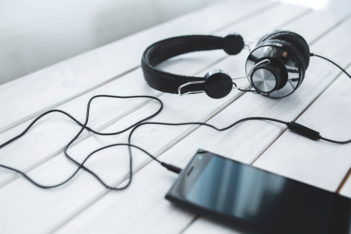 Metallic headphones on a table. Visit Kaboompics for more free images.