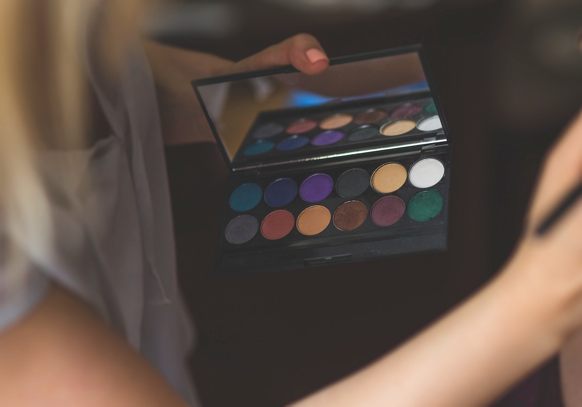 Woman putting on makeup. Visit Kaboompics for more free images.