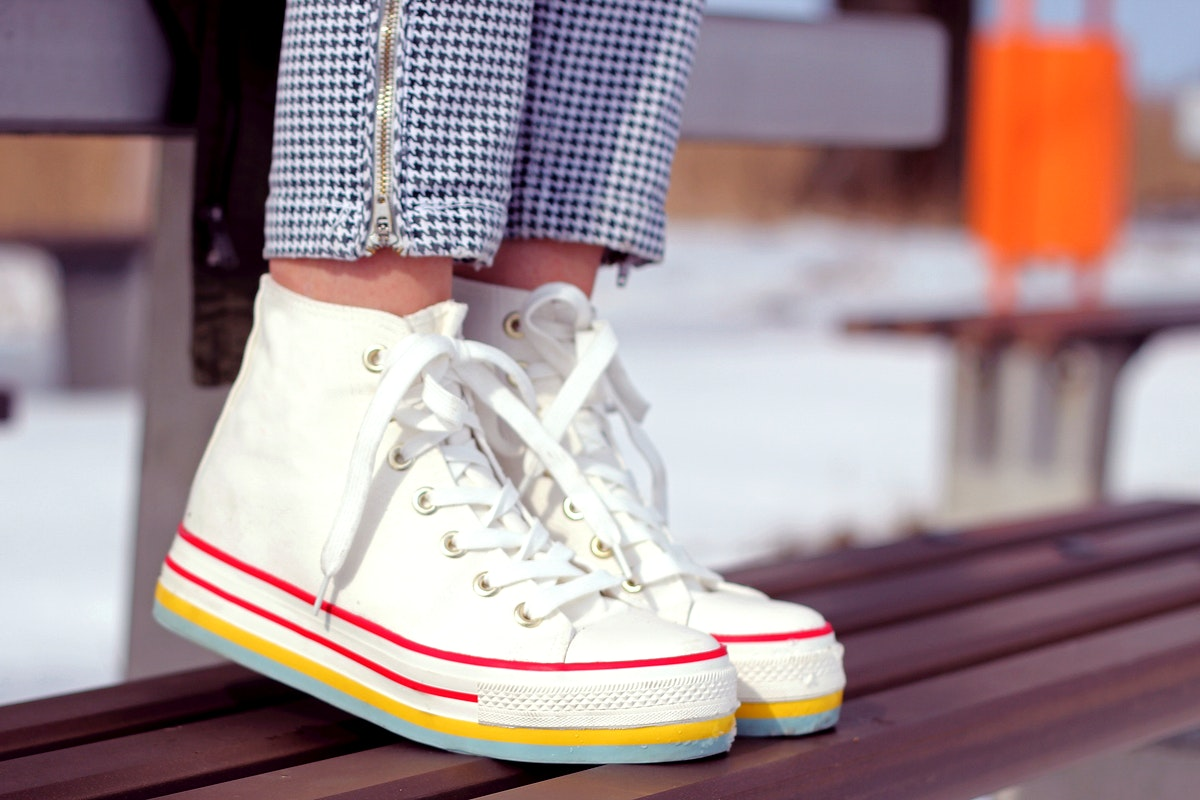 Close up of a woman in sneakers. Visit Kaboompics for more free images.