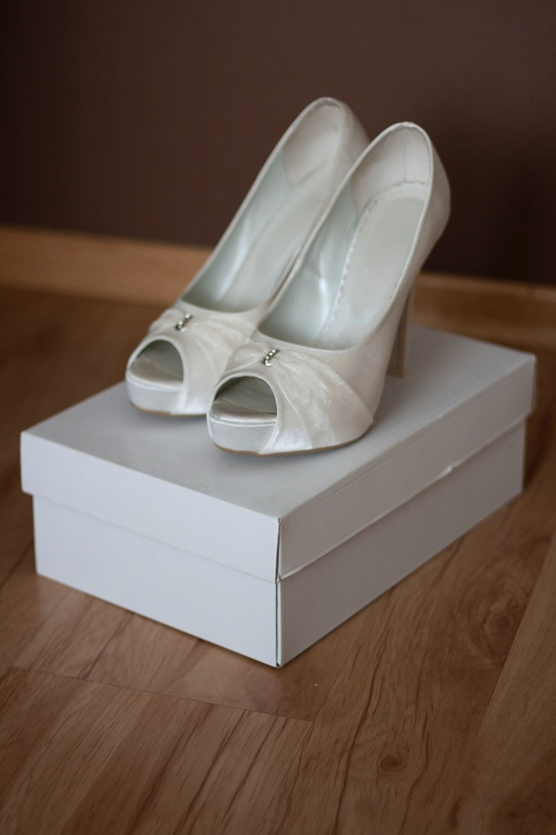 White bridal pumps. Visit Kaboompics for more free images.