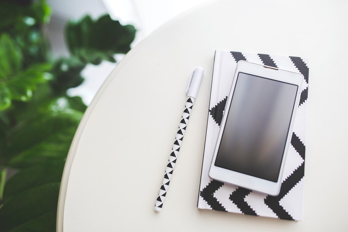 Smartphone on a table. Visit Kaboompics for more free images.
