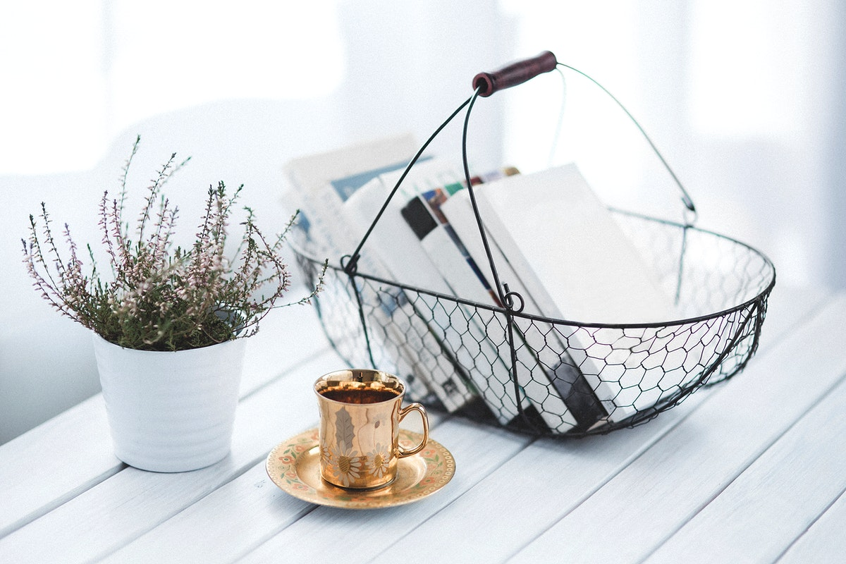 Basket with books on a desk. Visit Kaboompics for more free images.