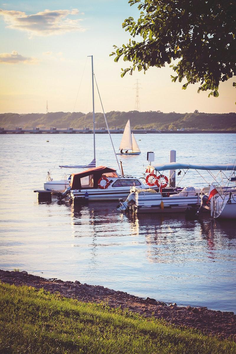 Sailboats tied at a pier. Visit Kaboompics for more free images.